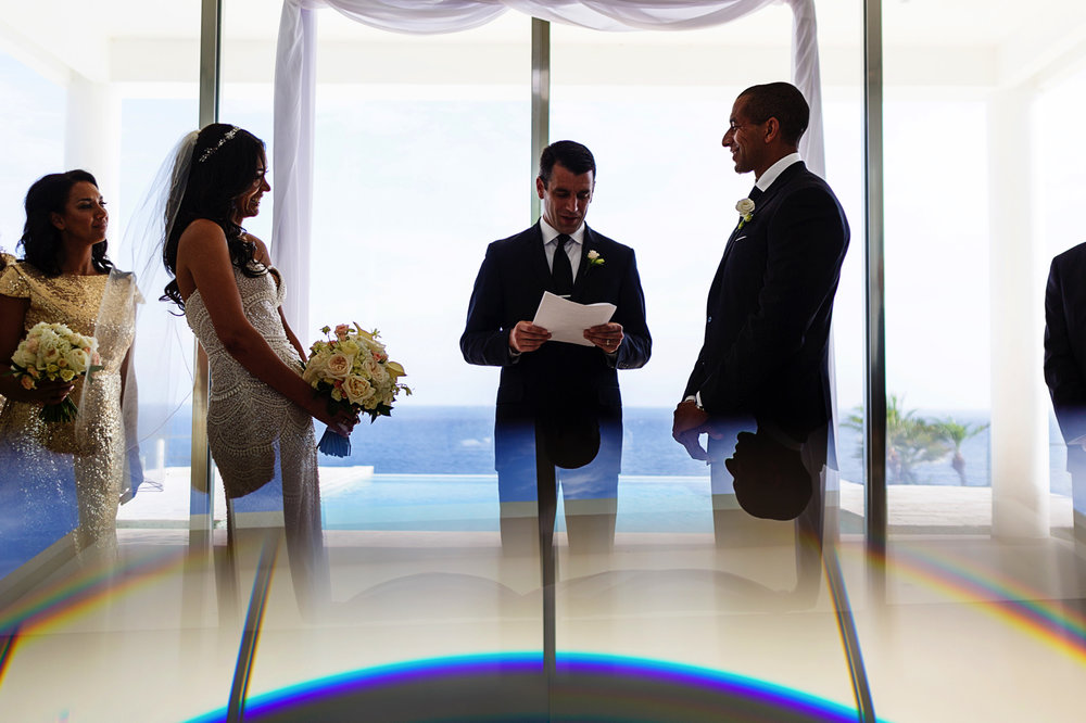 groom-looks-at-bride-during-ceremony