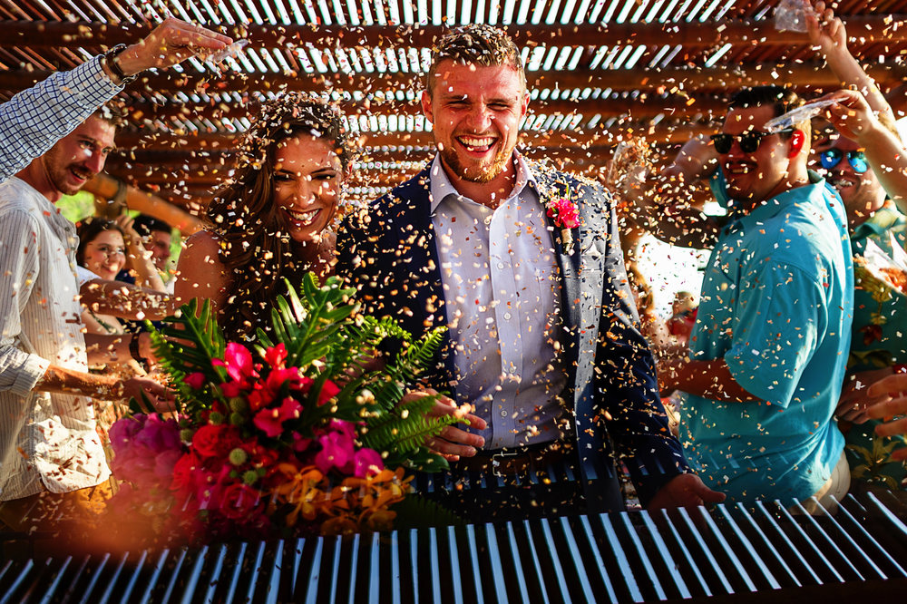 Exit of groom and bride with confetti