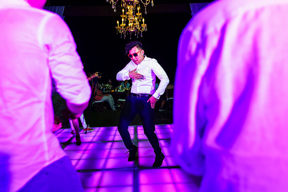 Wedding guest bringing super cool dance moves during the destination wedding party.