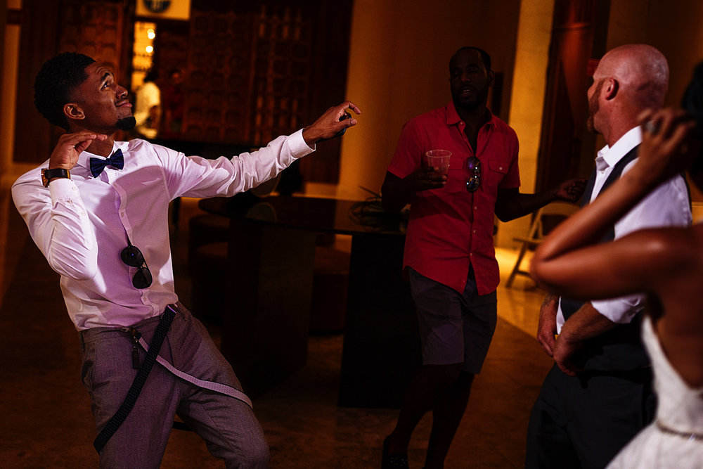 Wedding guest showing his best moves in the dance floor at the Hyatt Ziva ballroom