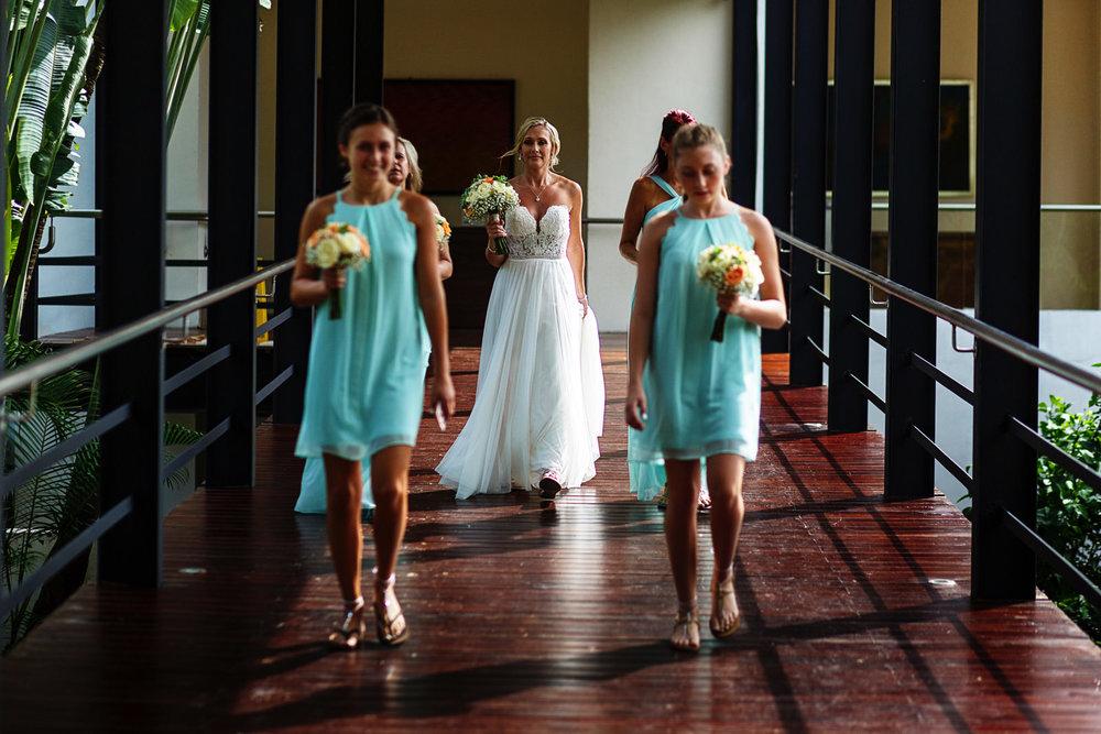 Bride walking through the bridge at Hyatt Ziva with all of her bridesmaids