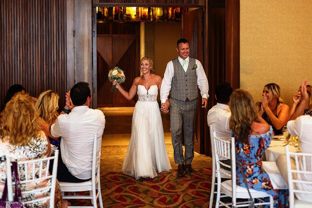 Groom and bride entrance into the reception at the Hyatt Ziva ballroom