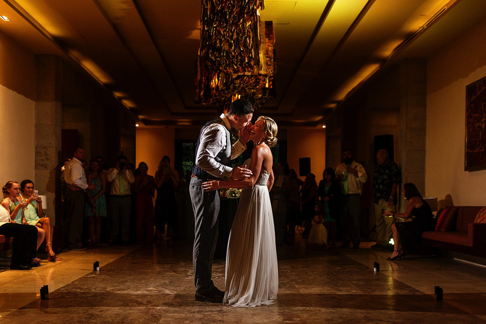 Groom tell a secret to the bride in the middle of their first dance
