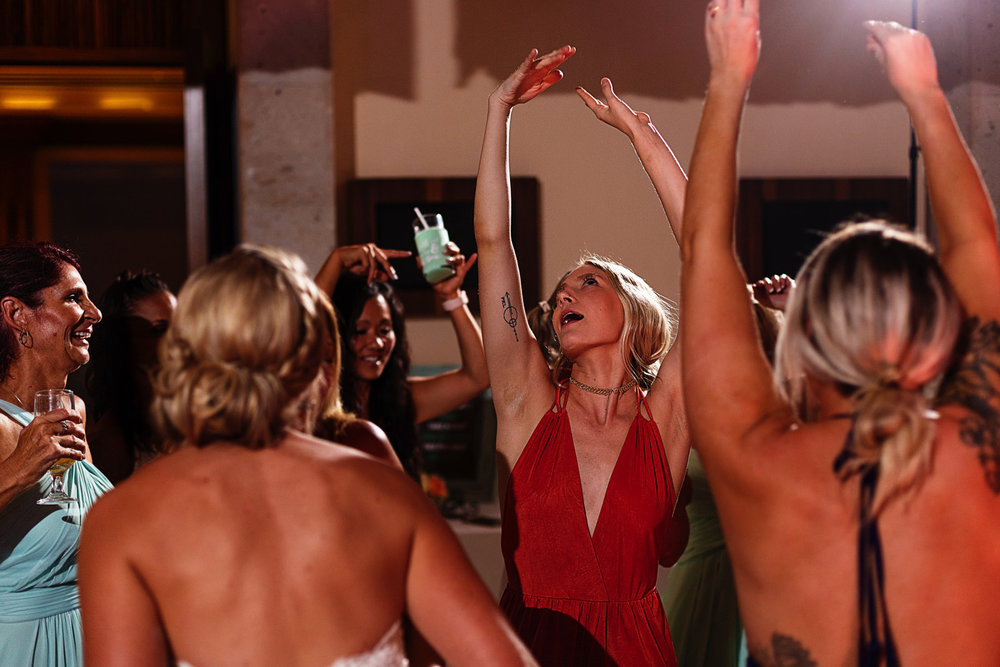 Wedding guests raise their hands in the air like they just don't care at the party
