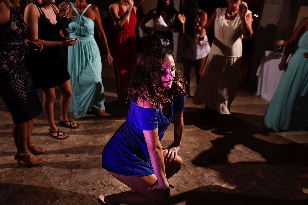 Wedding guest going down to the floor while dancing