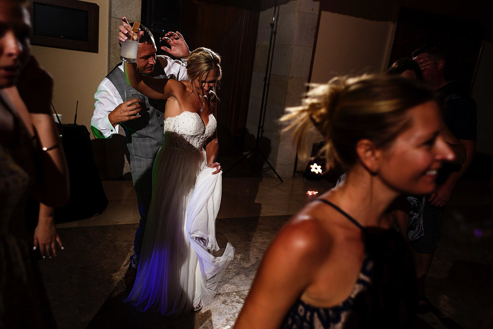 Groom and bride dancing during their wedding's party time
