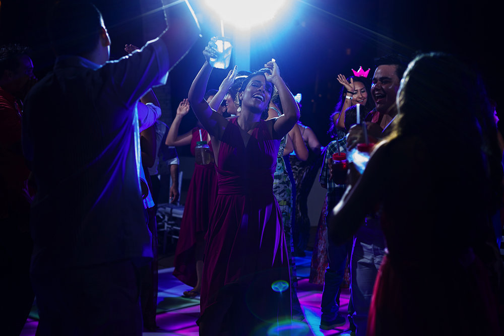Wedding guest dancing under the shinny DJ lights
