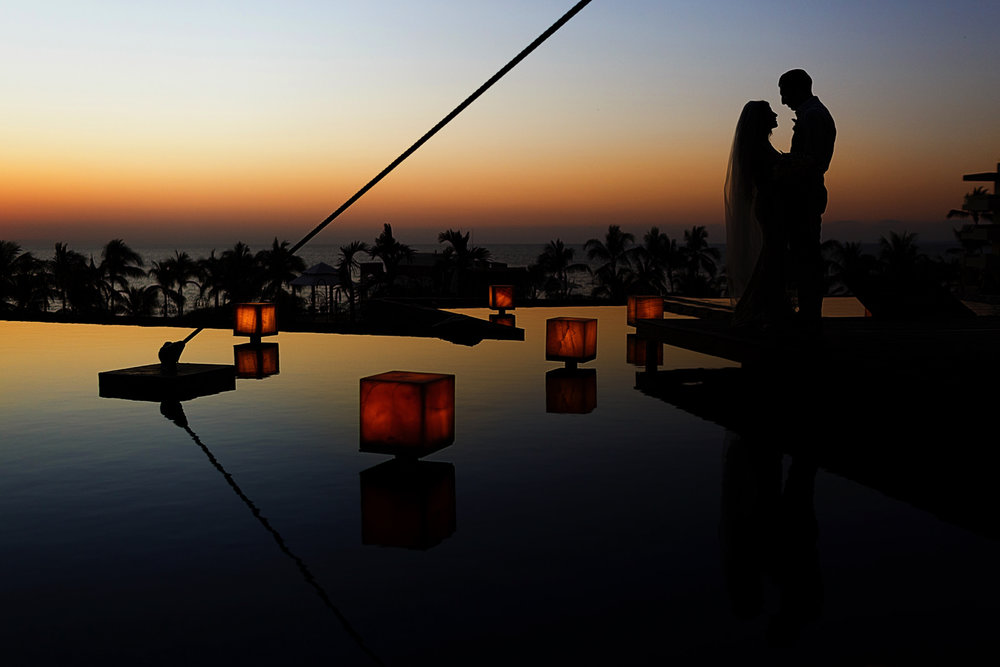 Silhouette of groom and bride at sunset on the Now Amber Puerto Vallarta platform