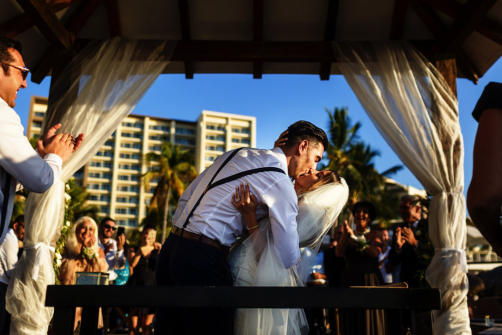 Groom kiss the bride at the end of the ceremony