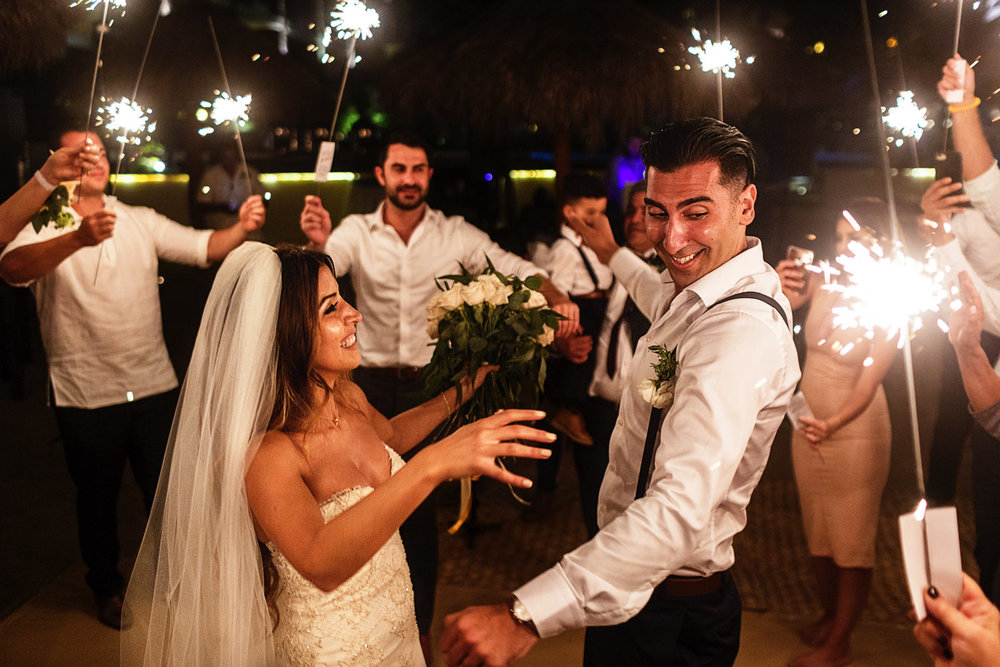 Groom almost burns with sparklers around him