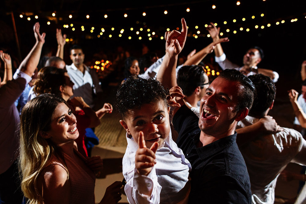 Toddler having a blast in the dance floor at the wedding party