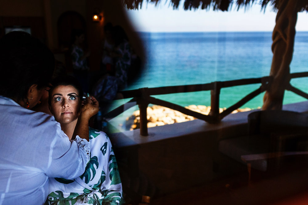 bride-getting-ready-ocean-window-make-up.jpg
