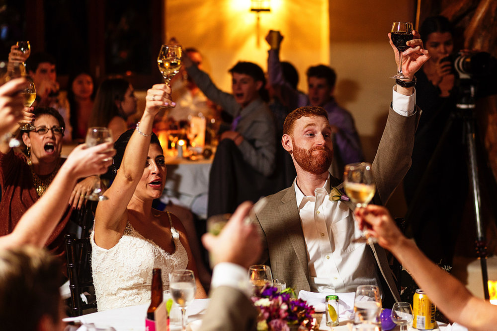 wedding-champagne-raise-glass-groom-bride-toast.jpg