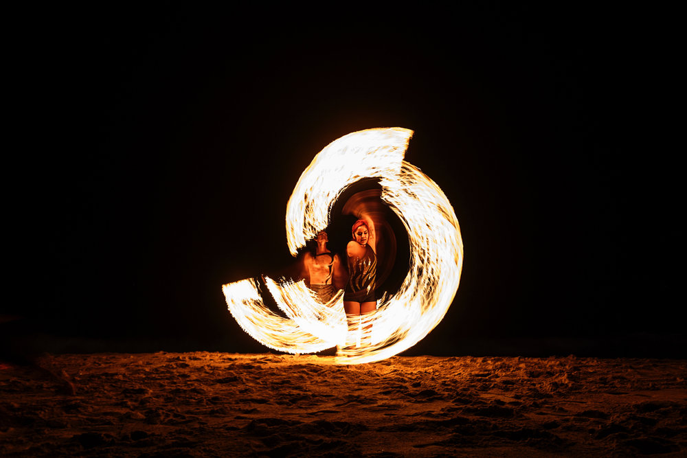 Fire dancers at Mantamar beach club performing for the wedding guests