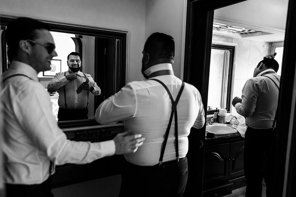Groomsmen getting ready in the bathroom at La Mansion Vallarta villa