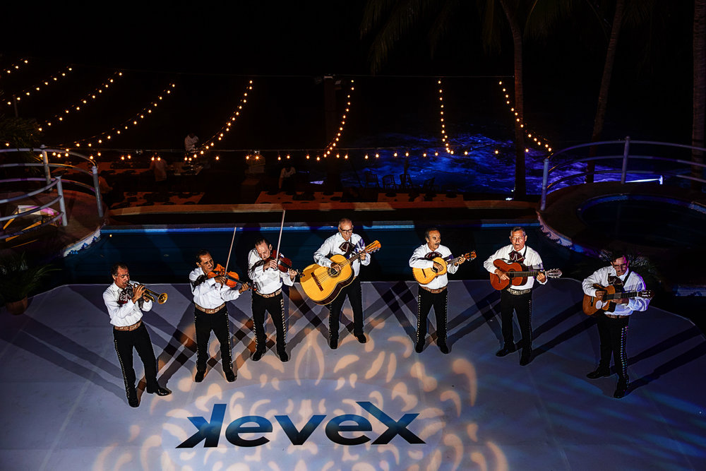 Mariachi band performs for the wedding guests and family at the dancefloor on top of the pool from La Mansion Vallarta villa