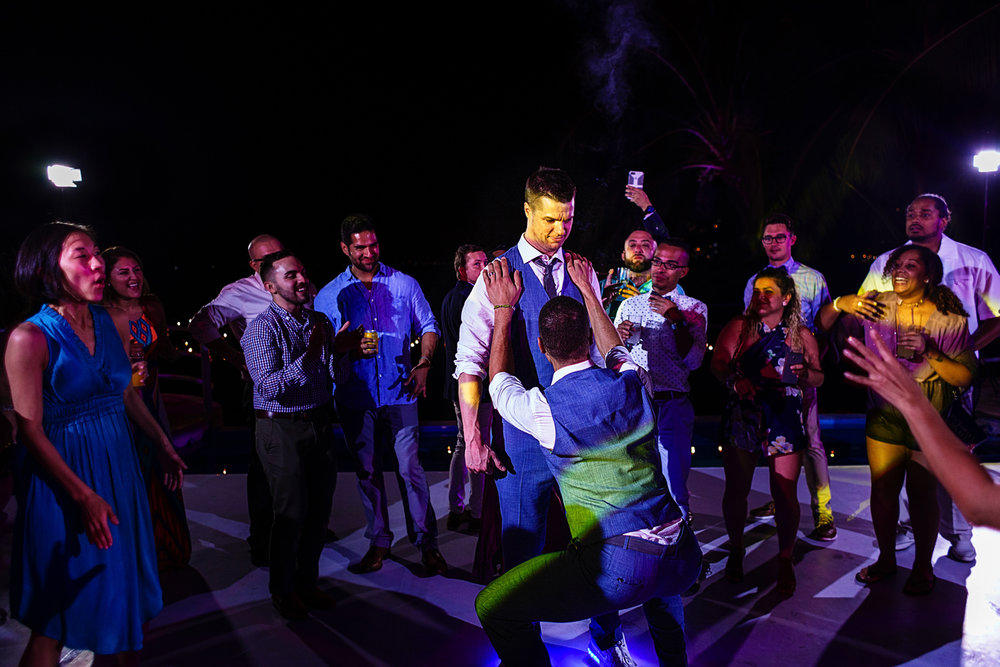 Grooms dancing with guest at the dancefloor in La Mansion Vallarta villa