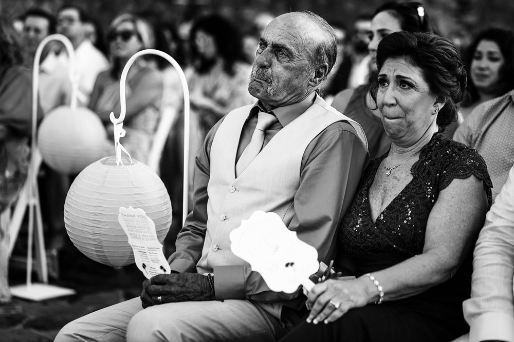 Parents of the bride holding their crying during the wedding ceremony