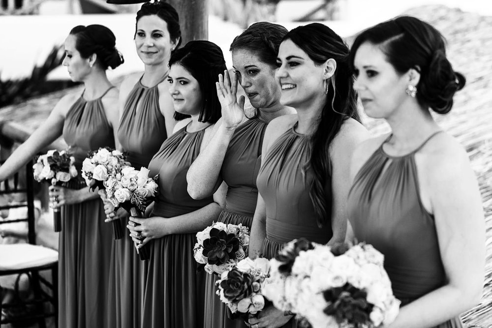 Bridesmaids reacting to the wedding ceremony