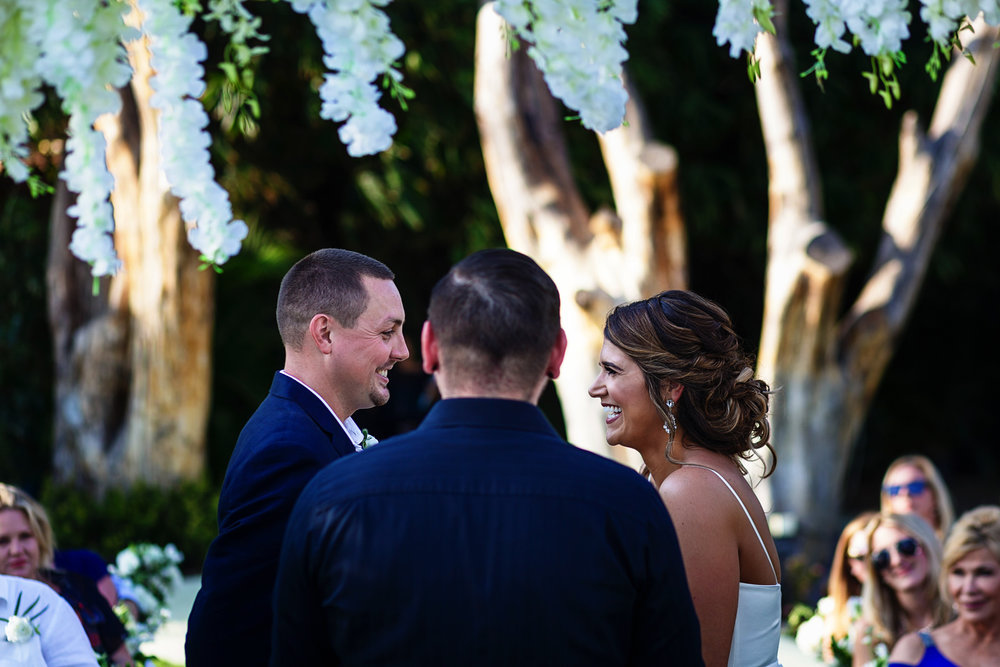 Bride and groom laugh during their wedding ceremony