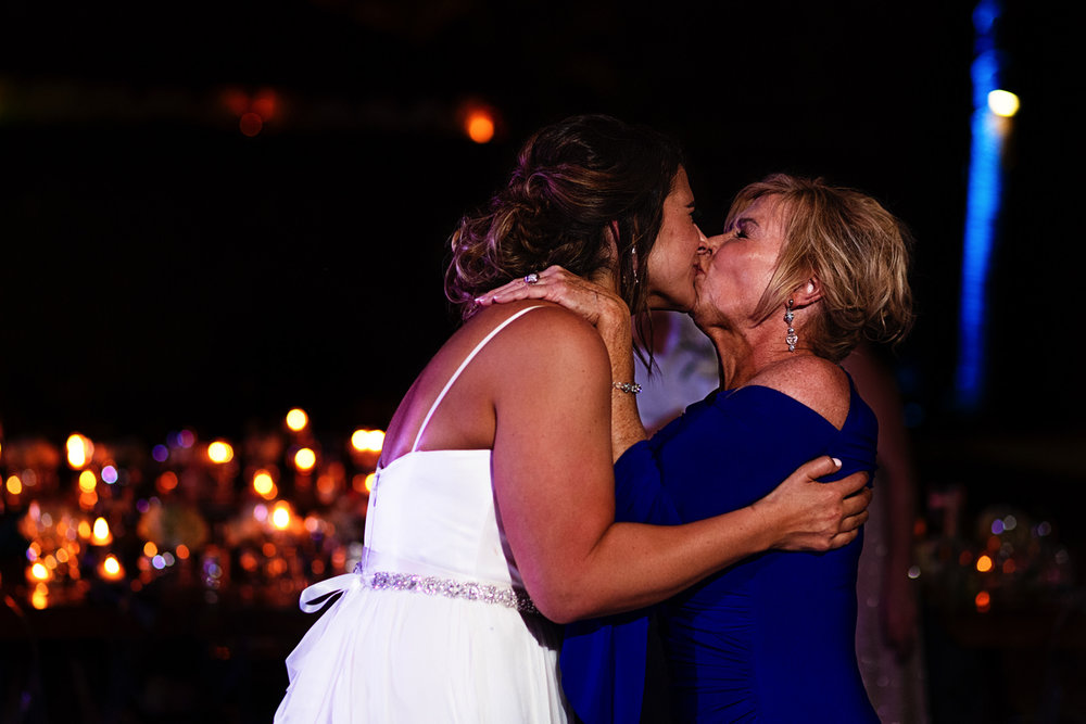 Mother of the bride kiss her with all of her strength