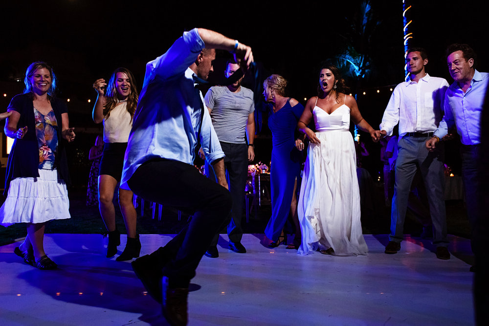 Wedding guest getting his best dance moves out in the dancefloor