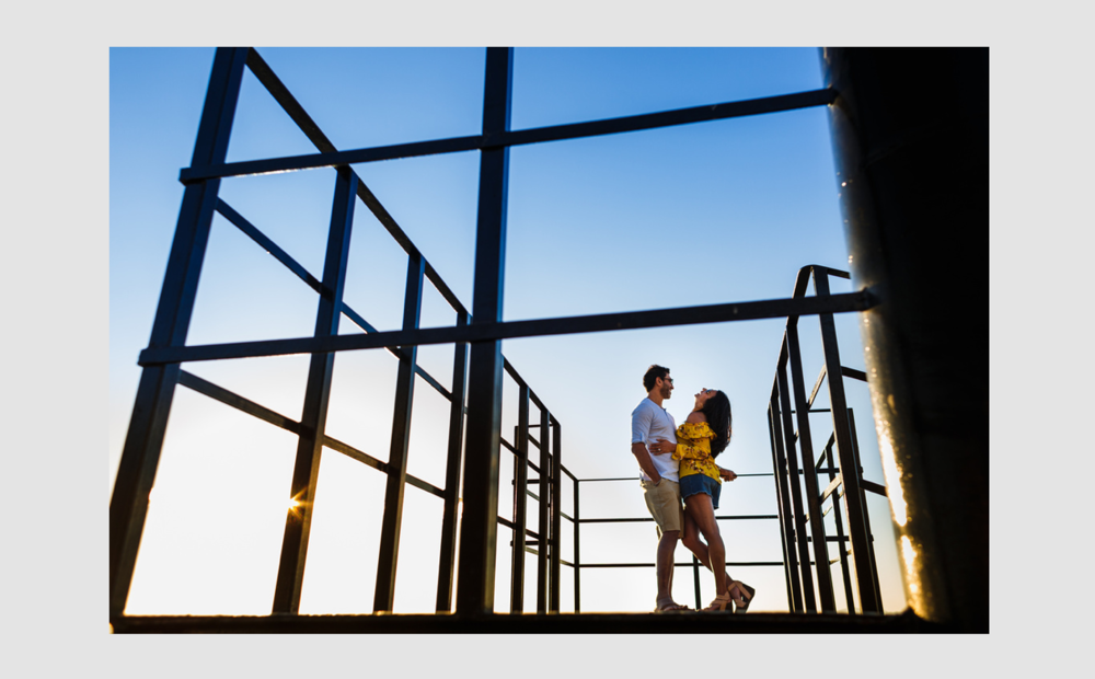 Couple casual portrait through the railing of the old lighthouse.