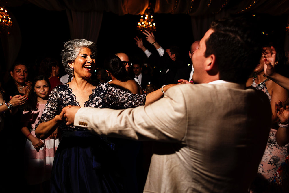 Mother of the groom dance with a wedding guest