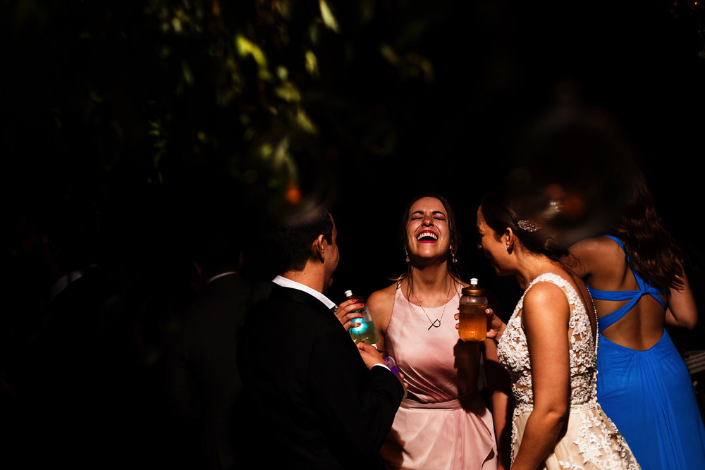 Bride and friends joking and having a great time