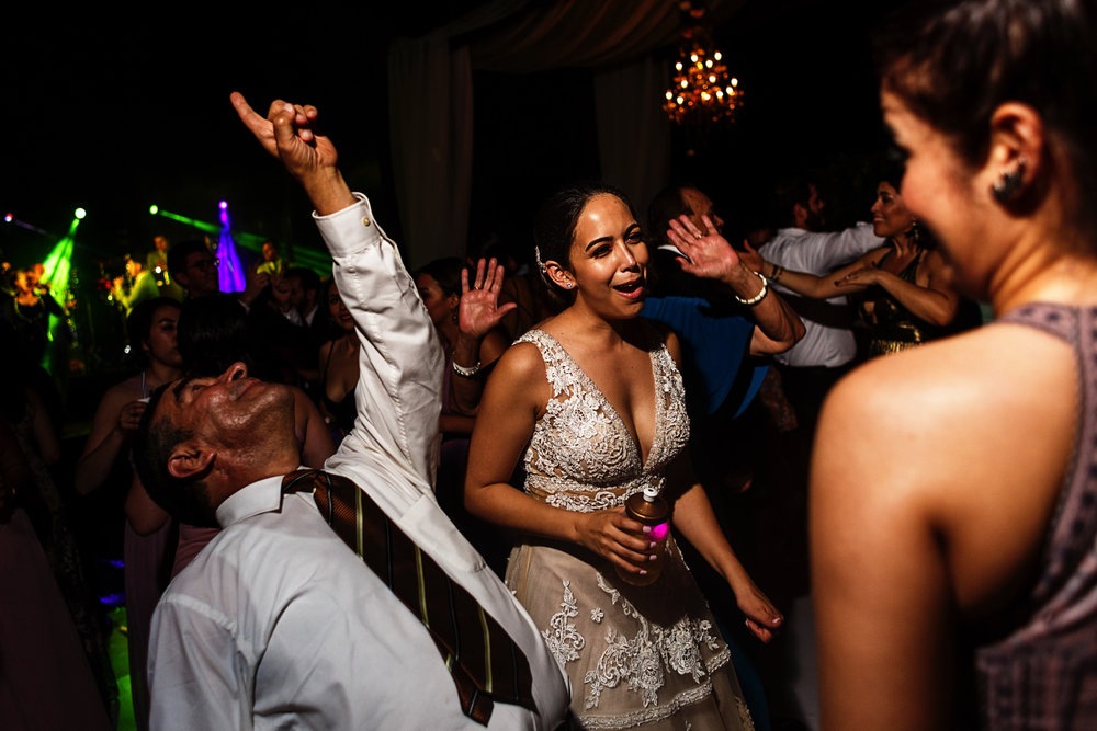Bride next to a wild dancer