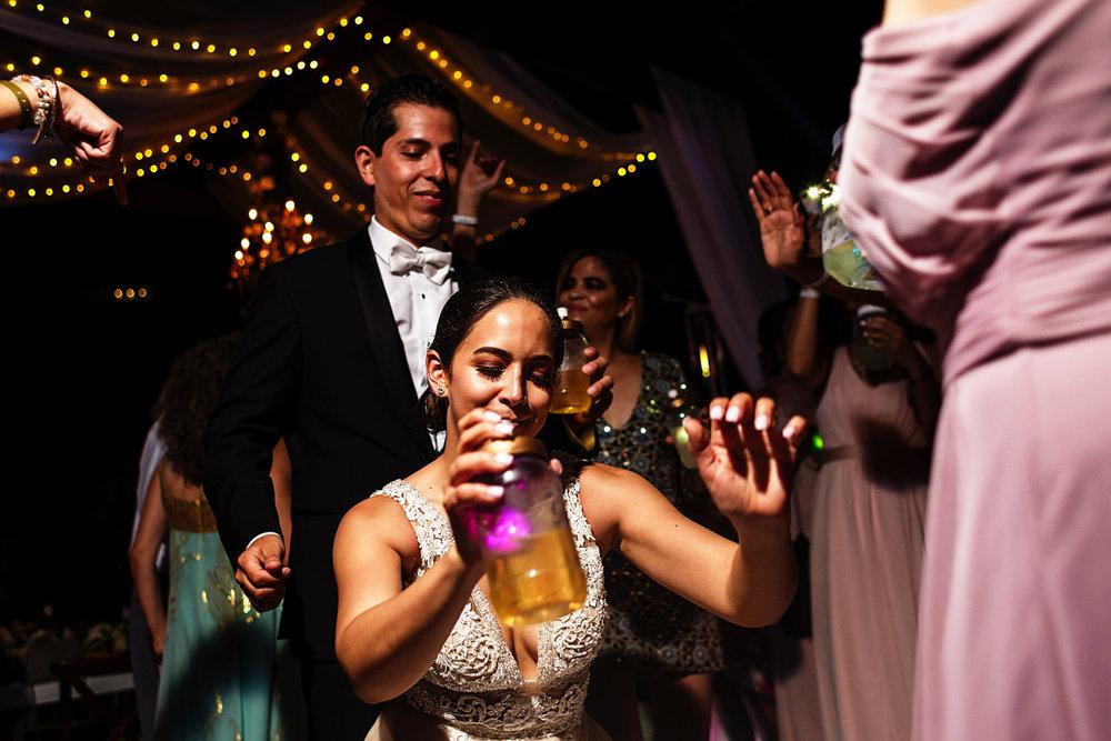 Bride going down dancing in front ofthe groom