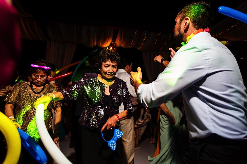 Wedding guests dancing and shaking balloons