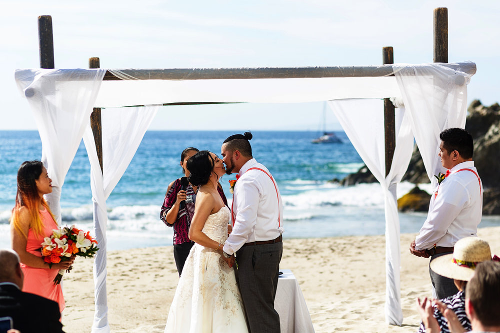 Bride and groom about to have their first kiss at the end of their wedding ceremony on the beach