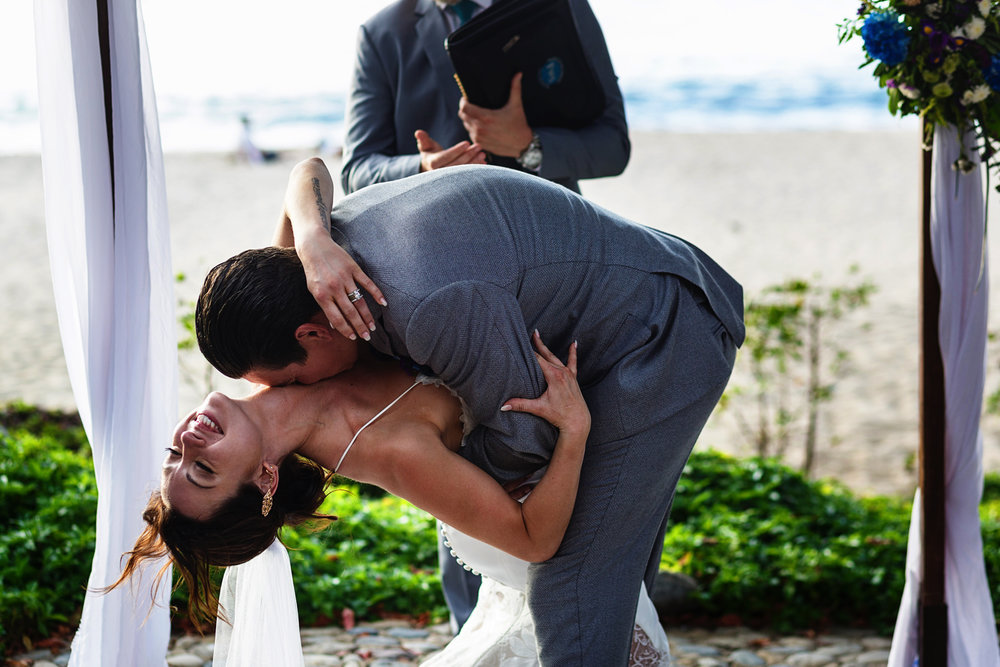 Great first kiss at the end of the wedding ceremony in Sayulita