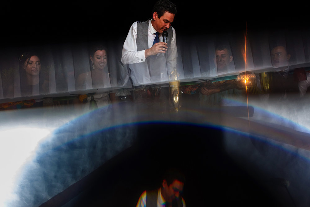 Groom's speech creative photo using a prism reflection and flare