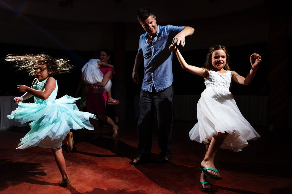 Girls dancing and spinning during the wedding party