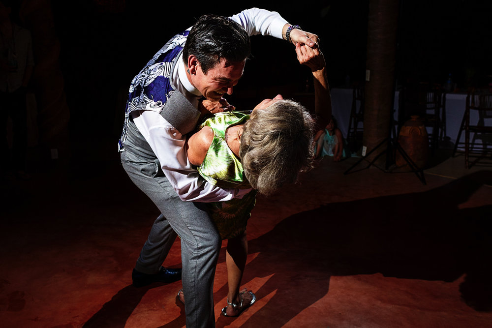 Groom leans his mother at the end of their dance as mother and son