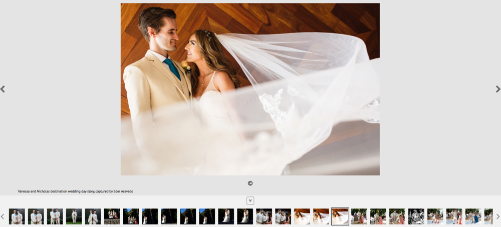 Groom and bride facing at each other with the veil floating in the air