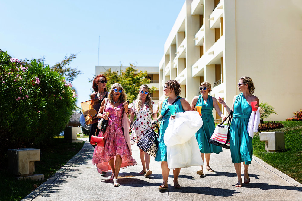 Bride and bridesmaids walking out the Iberostar Punta Mita resort