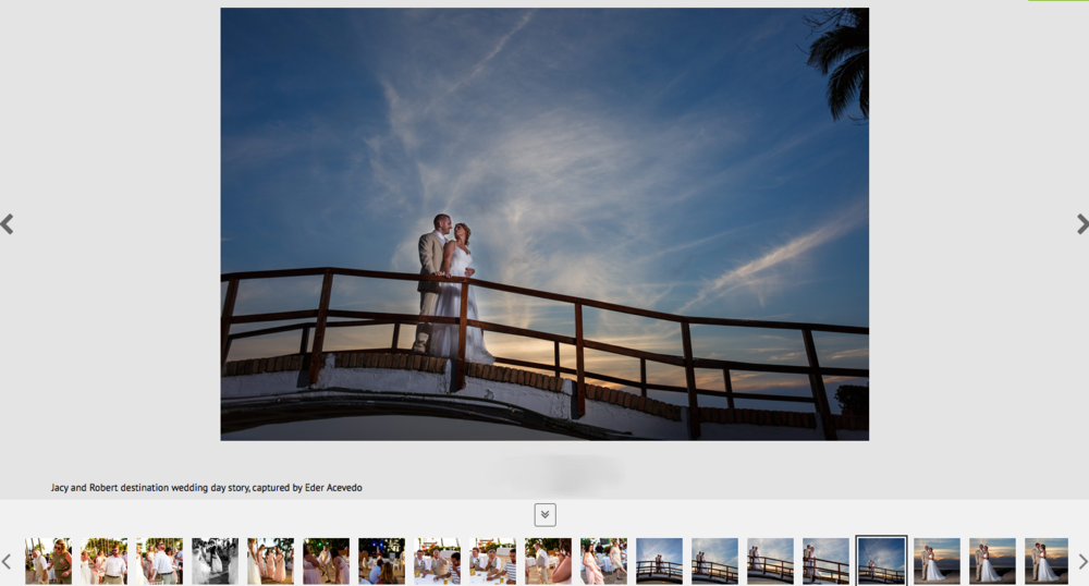 Married couple standing over the Hyatt Ziva bridge with the sunset in the background