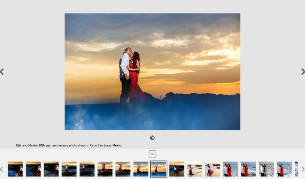 Married couple kissing over a rock among clouds with the sunset in the background