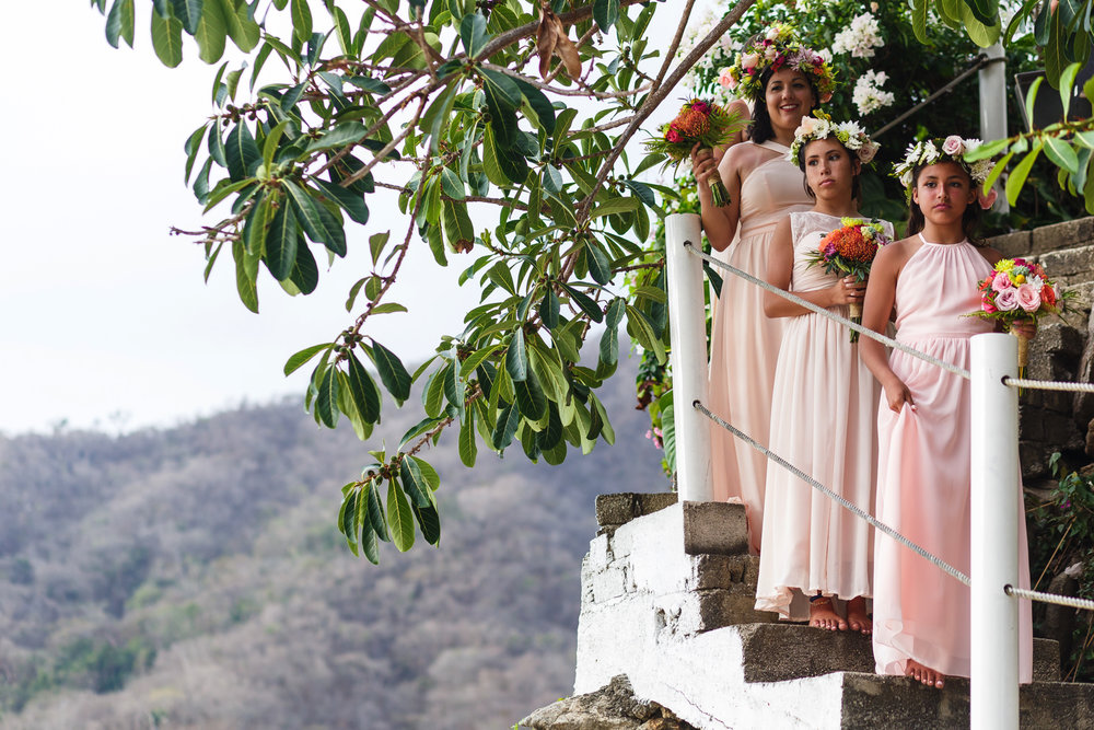 Bridesmaids waiting to be call for the procesional of the wedding ceremony on the staircase of Miramar Yelapa.