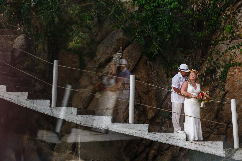 Groom and bride portrait on the staircase of Miramar Yelapa that takes you down to the beach.