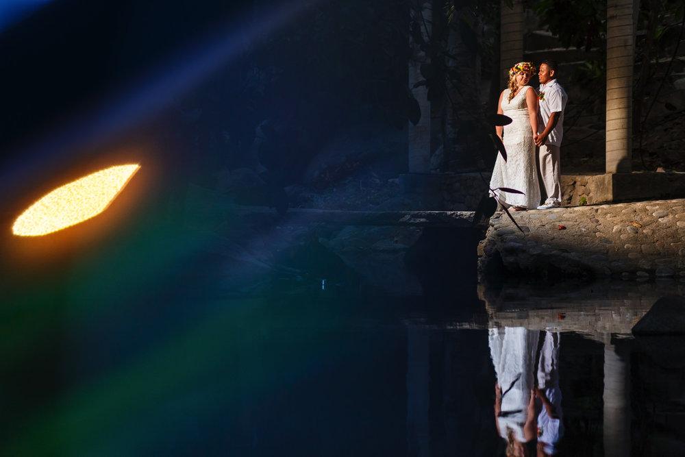 Creative bride and groom portrait over a pond in Yelapa.
