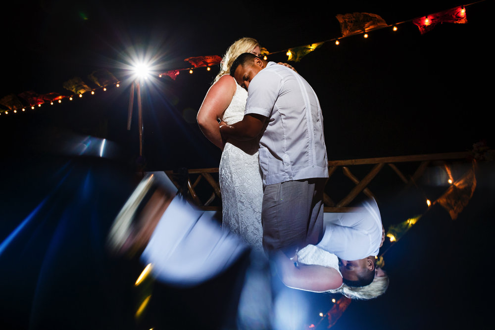 Groom hugs the bride during the first dance at the Miramar terrace.