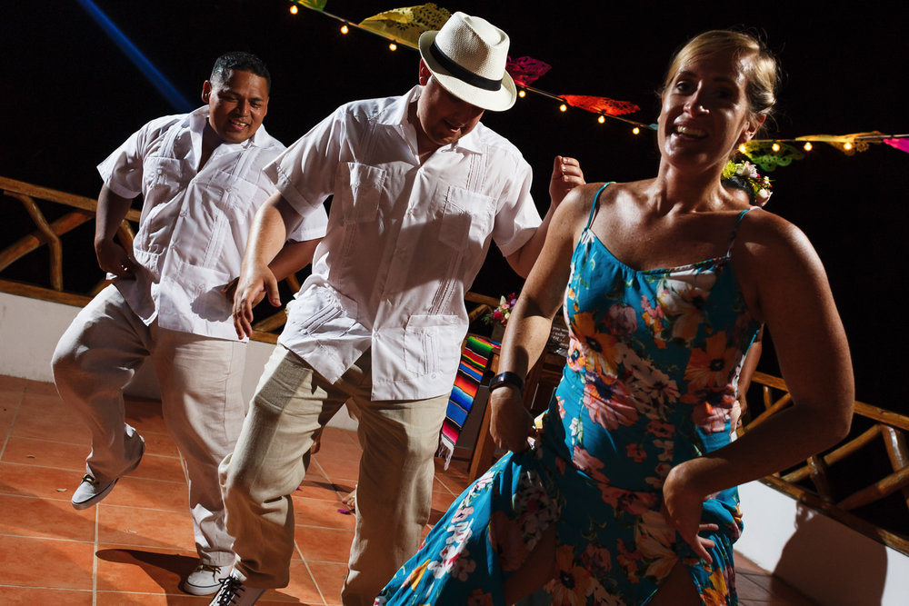 Groom and wedding guests dancing at Miramar terrace in Yelapa, Mexico.