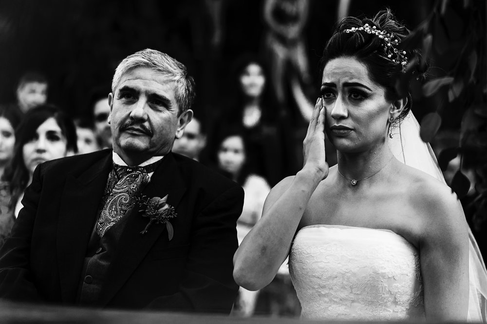 Bride and groom on their wedding ceremony at Hotel Boutique Montecruz in Atemajac, the bride is crying .