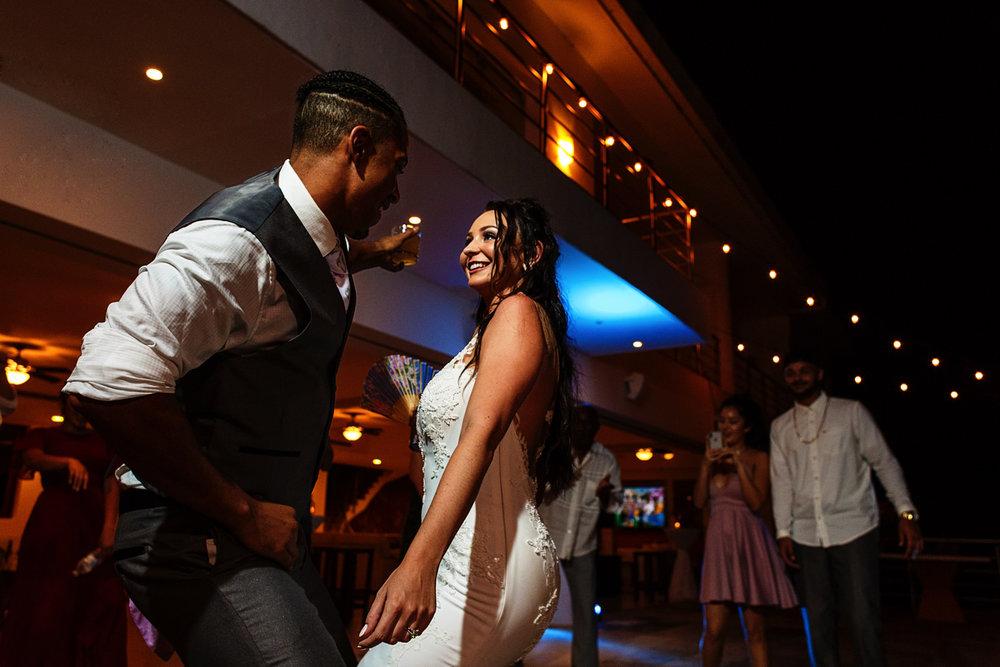 Bride and groom dancing and having fun.