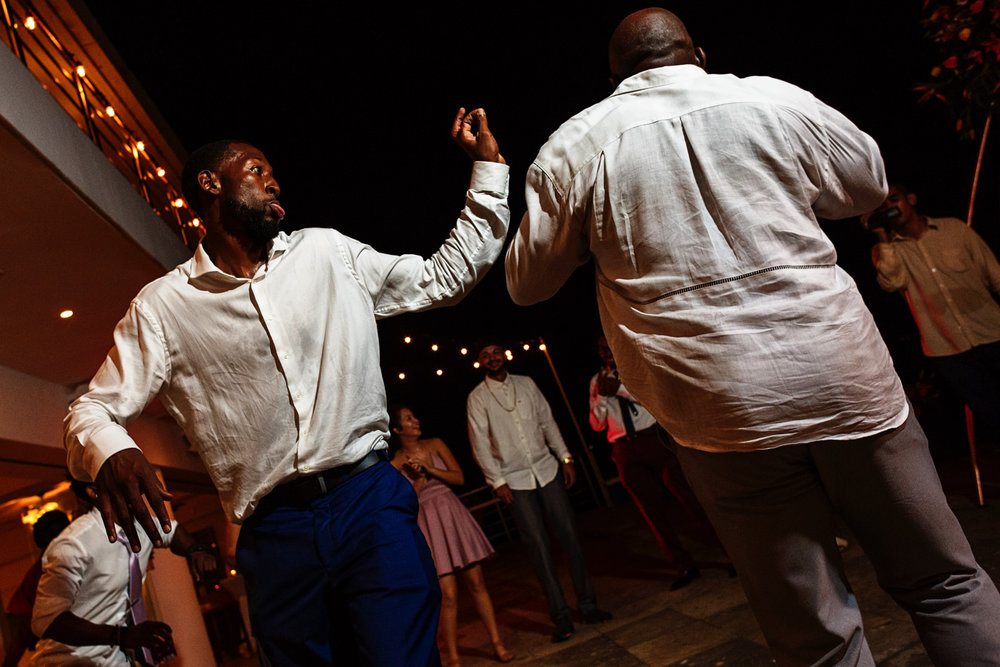 Wedding guests friends dancing and having fun.