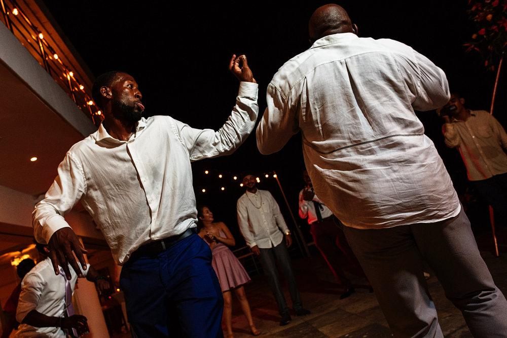 Wedding guests friends dancing and having fun.